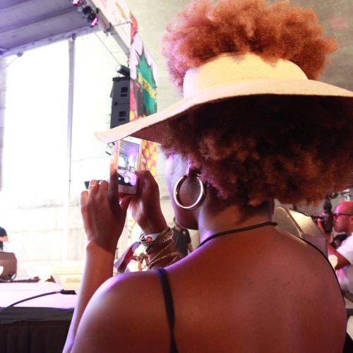 LaTonya Yvette taking a photo of the Essence Style stage