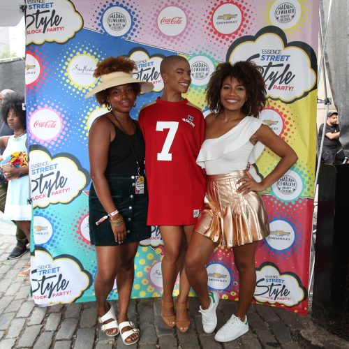 Style Squad' influencers Heygorjess, Divas and Dorks and LaTonya Yvette pose for a photo in front of the photo backdrop