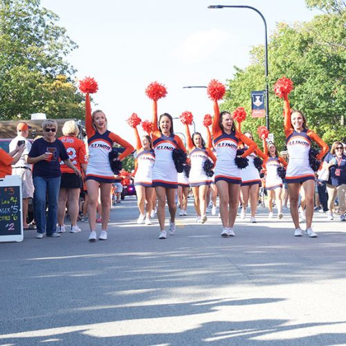 The Fighting Illini cheer team during the Illini march at Grange Grove outside Memorial Stadium